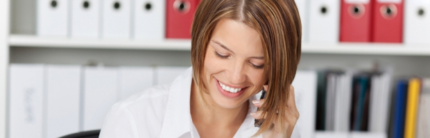 Woman talking on the phone in office