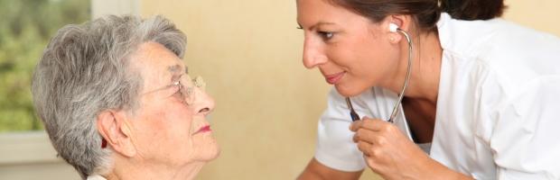 Elderly person with nurse
