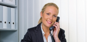 A friendly woman phoned at her desk